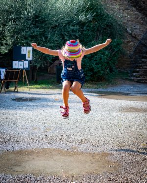 Young girl jumping for joy.